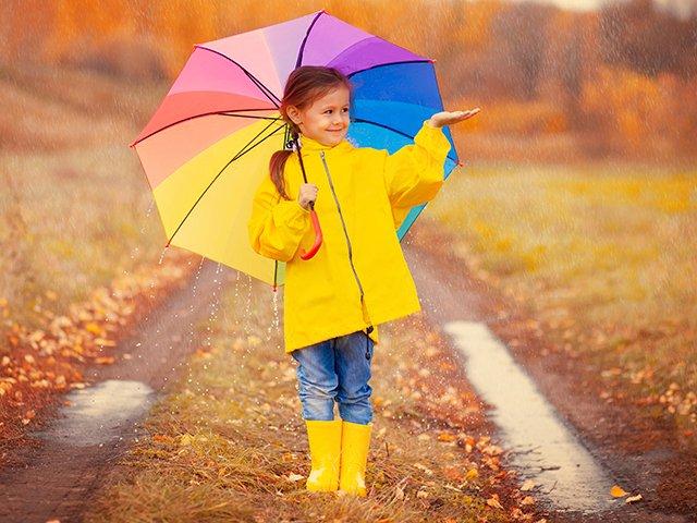 girl in rain with umbrella.jpg