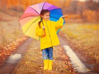 girl in rain with umbrella.jpg