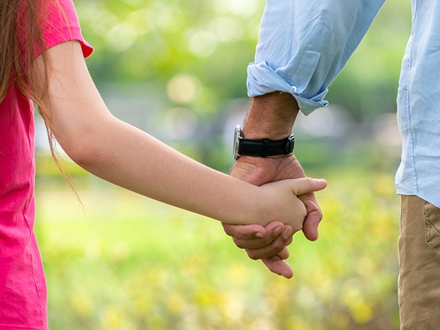 father holding daughter's hand.jpg