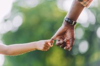 grandfather hands with grandchild.jpg