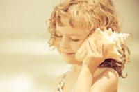 child listening to shell.jpg