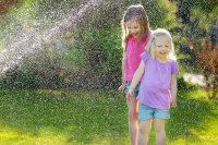 kids in sprinkler.jpg