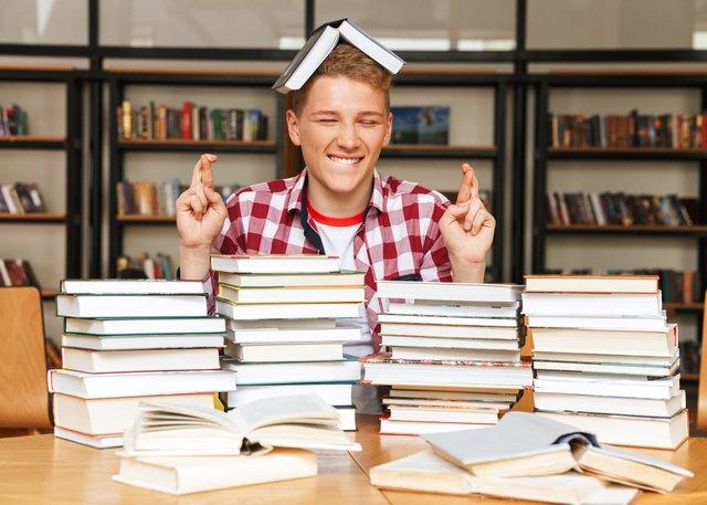 teen studying fingers crossed.jpg