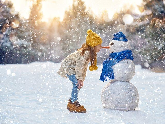 girl with snowman.jpg