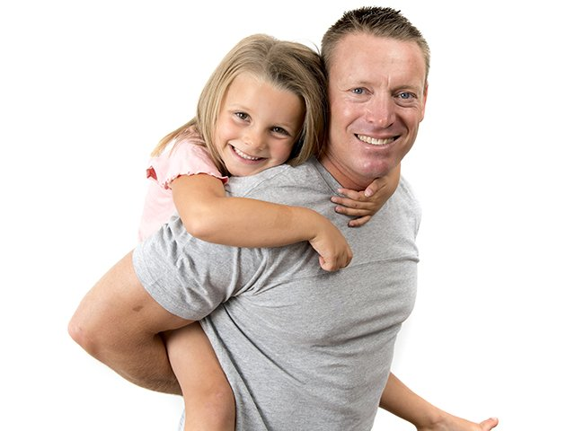 father with daughter piggyback ride.jpg