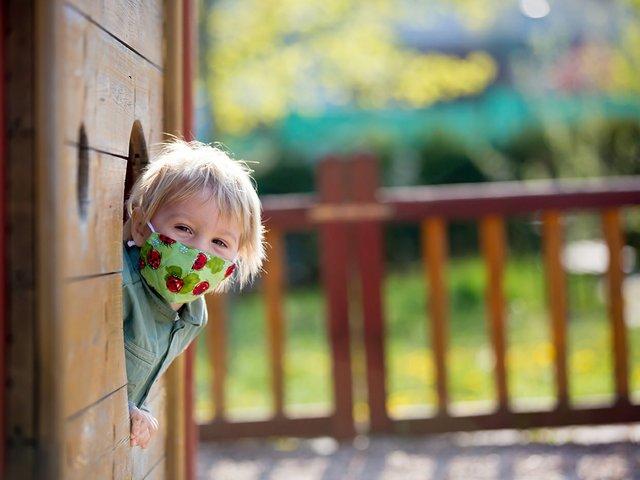 boy in mask on playground.jpg