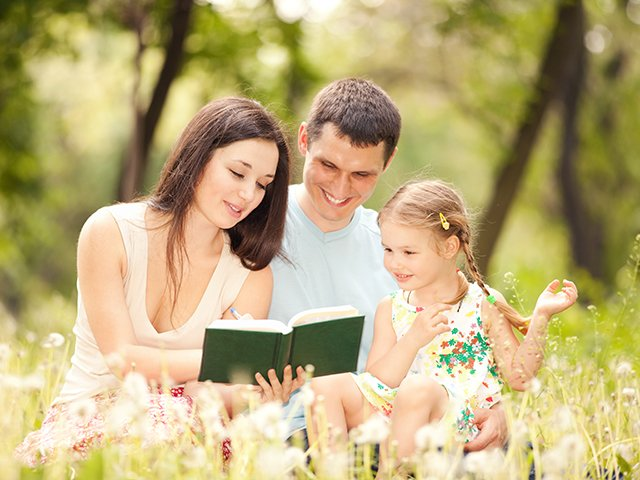 family reading outside