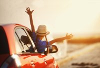 girl with arms out window of car happy.jpg