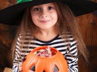 girl with pumpkin halloween candy.jpg