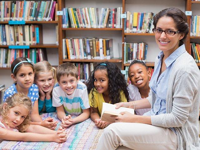 Librarian with children