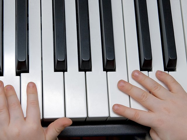 boys hands on piano close up.jpg