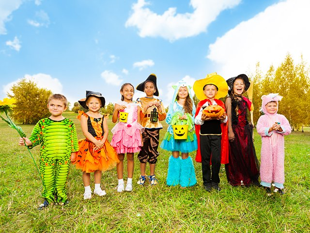 group of children in Halloween costumes ourside.jpg