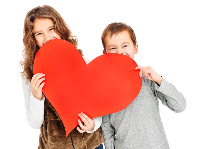 siblings with red heart