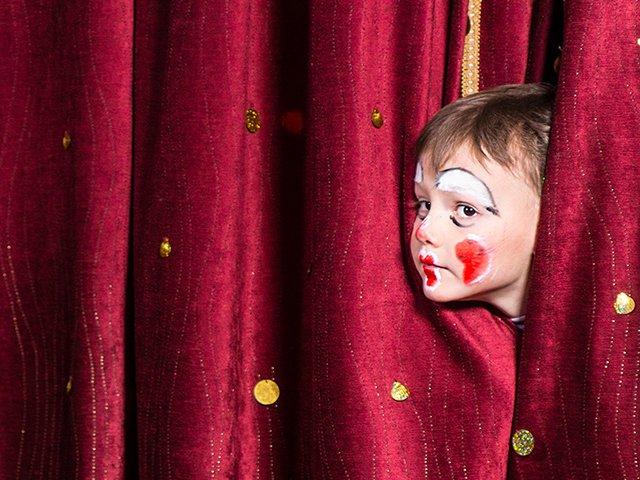 Impatient little boy on stage