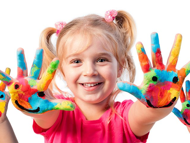 Preschooler with painted hands