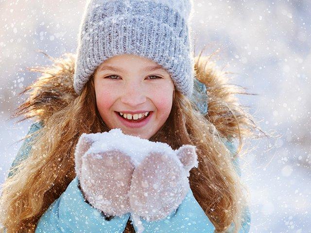 girl blowing snow.jpg
