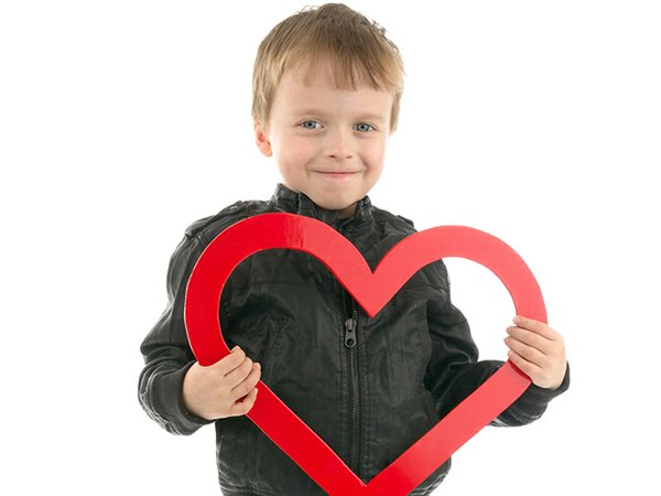 young boy with heart