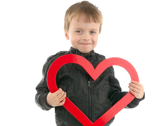 young boy with red heart.jpg