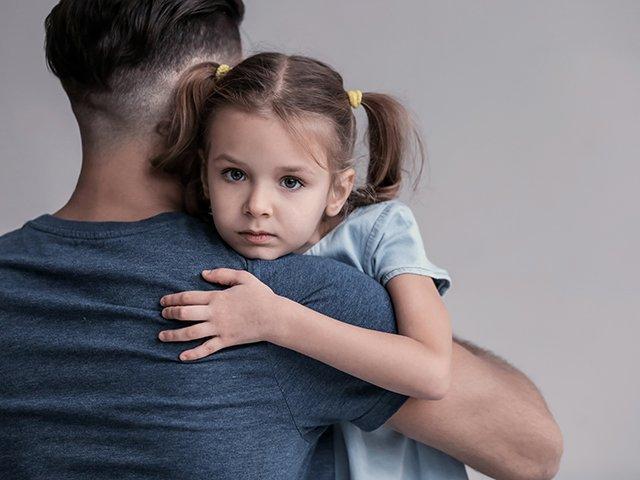 sad child with father.jpg